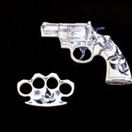 Brass Knuckles and Colt 357 Trooper